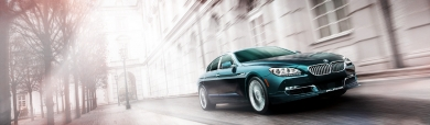 green-bmw-alpina-gran-coupe-car-in-city-website-header