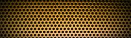 golden-punctured-metal-sheet-background-header