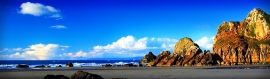 sea-coast-rock-mountain-and-sky-header